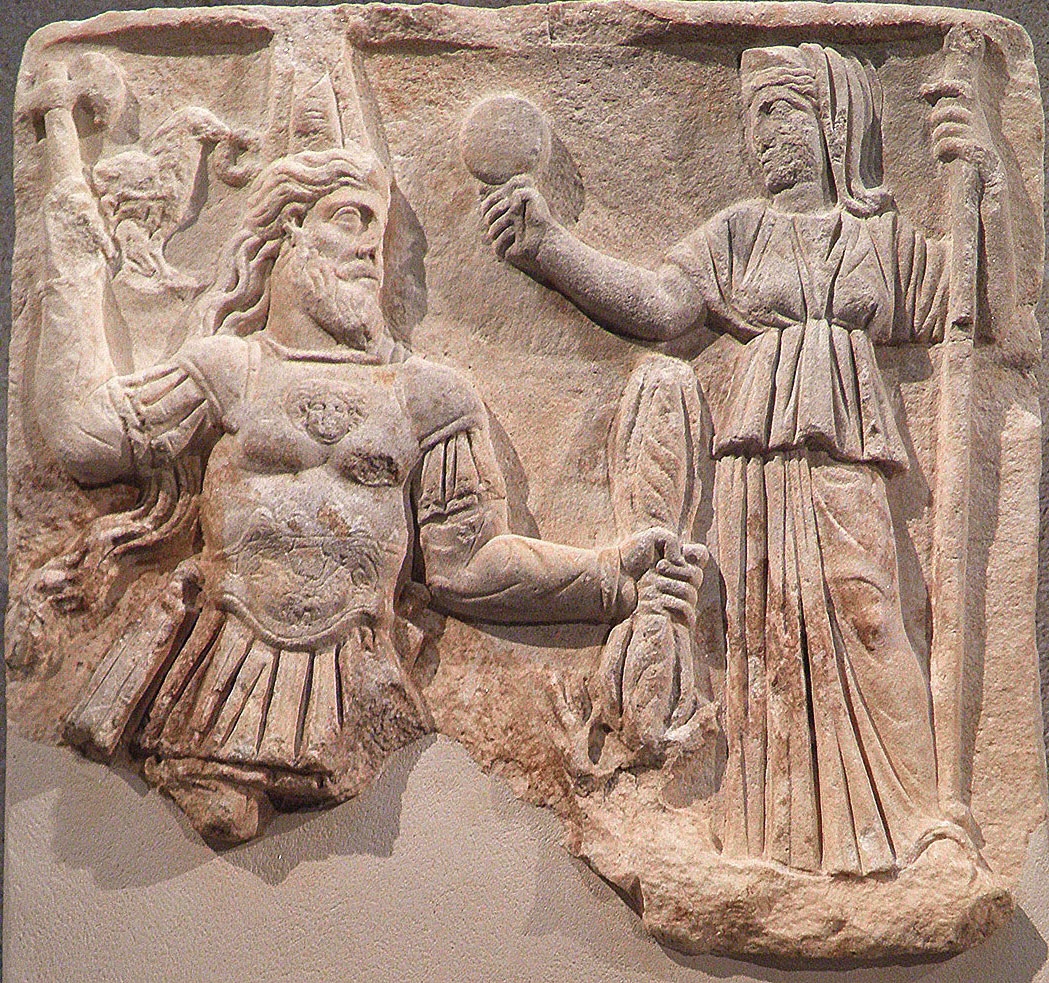 Votive relief to Jupiter Dolichenus and Juno, Jupiter with Armenian tiara, sword, an ax and lightning bundle, Juno has a mirror and a scepter, 3rd century AD, from Rome, Neues Museum, Berlin